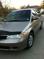 2004 Honda Odyssey EXL with dual sliding door and DVD player.