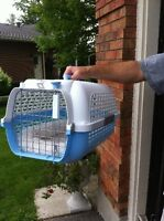 Like new small baby blue crate with white bed