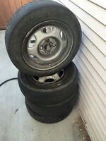 FOUR 2002 Toyota Corolla rims and tires 175/65/14