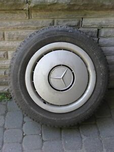 Mercedes Hubcap and Rim with Pirelli Tire