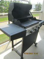 Large BBQ on wheels with side burner comes with tank