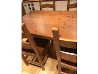 Solid wood table and 6 chair's for sale great condition!