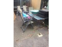 Garden table and 5 chairs. Free to collect this weekend