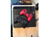 PlayStation 4 (PS4) w/ 2 controllers