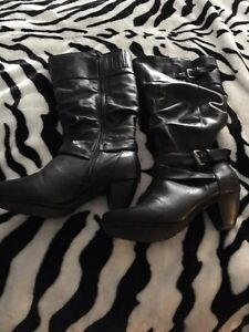 Knee high leather boots. Barely used. 12 wide