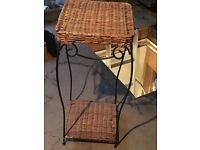 Rattan an iron table for lamp or plant