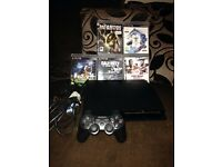 PS3 for sale with five games