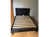 Black faux leather double bed