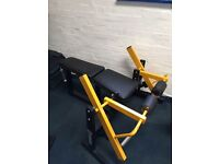 Commercial gym equipment plate loaded leg curl
