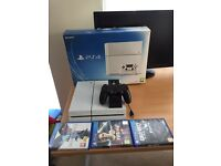 PlayStation 4 white with games