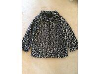 Girls fluffy coat. Age 5-6.
