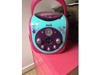 cd player / karaoke machine (no microphone inc) plugs into tv (leads can be brought sep) good cond