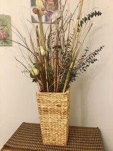 Wicker basket with foliage