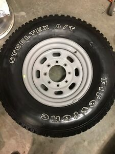265/75r16 tire with rim.