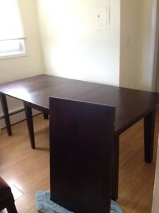11 foot expanding dining room table with 3 chairs