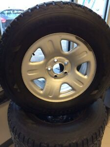 235/70/R16 Firestone Winter Force tires and rims