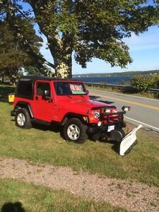 Jeep with snowplow and salter