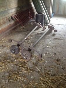 Trailer axles with electric brakes and wheels