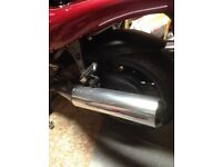 Triumph sprint exhaust cans