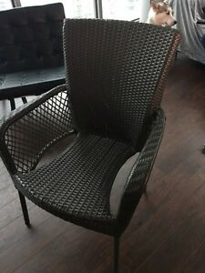 3 wicker patio chairs with white cushions