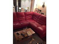 Large red leather corner unit sofa.
