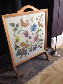 Antique embroidered fire screen