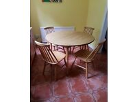 Round kitchen table and four chairs