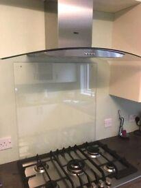 Clear toughened pre- drilled Glass splash back 70cm x 75cm