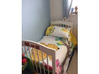 White wooden cot bed with mattress