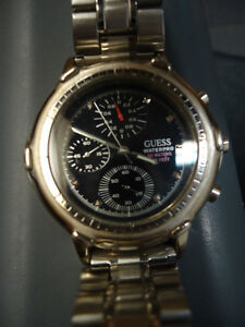 Stylish GUESS Multi-Function Men's Watch with Metal Strap West Island Greater Montréal image 1