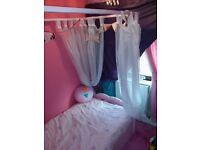 Girls pink 4 post bed with voiles good condition no damage. dismantled ready for collection £80