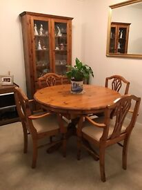 Ducal pine dining table, 4 carver chairs and matching display unit