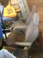 2 removable dodge caravan seats with rollers $160.00/for 2