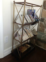 A book/cd/dvd shelf and a lamp