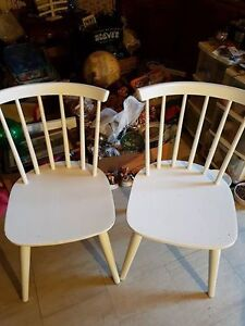2 white IKEA wooden chairs
