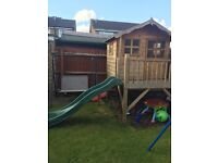 Children's wooden tower playhouse with slide for outdoor play!