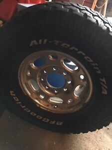 """8 bolt 16"""" rims and tires with centre caps"""