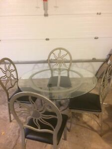 Cute glass table set with metal chairs