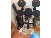Wii console 3 controllers guitar hero drums 2 guitars