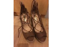 Brown lace up style wedges