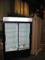 "BRAND NEW in the BOX. 53"" wide 2 sliding glass door refrigerator"