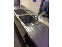 Double commercial sink with dry in both sides.