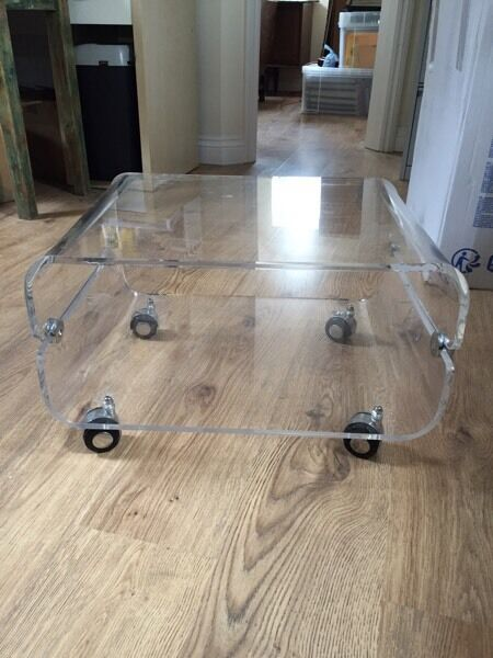 Acrylic two tier TV stand on castors