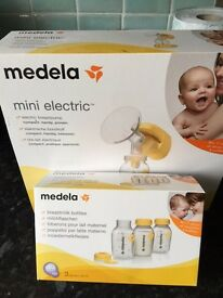 Medela mini electric breast pump and bottles with teats