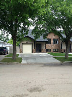 Half Duplex for Sale in Taber built by RENTAR HOMES