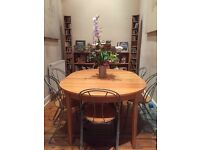 Extendable Round Dining Table and 6 Chairs