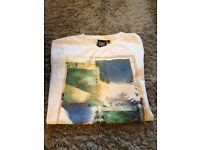Boys animal t shirt. Sold subject to collection