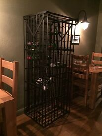 Wrought iron wine cage.
