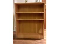 Light pine shelf, two available. 82.5H x 65.5W x 17D cm.