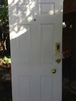 Solid WHITE front door with pass-code entrance